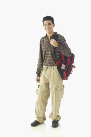 Portrait of teenage boy standing with backpack
