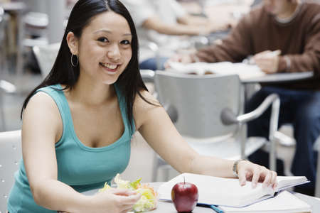 Female college student sitting at table