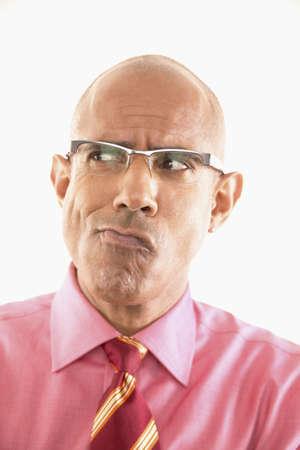 Portrait of a businessman making a face LANG_EVOIMAGES