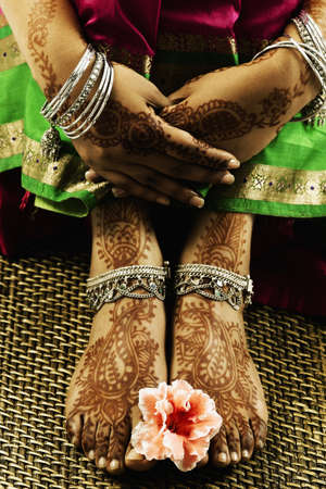 Womans feet with henna and ankle bracelets