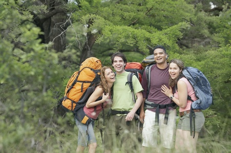 Portrait of two young couples hiking in a forest LANG_EVOIMAGES