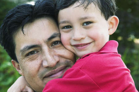Portrait of a man holding a young boy