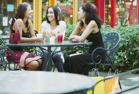 Three young women having lunch in mall