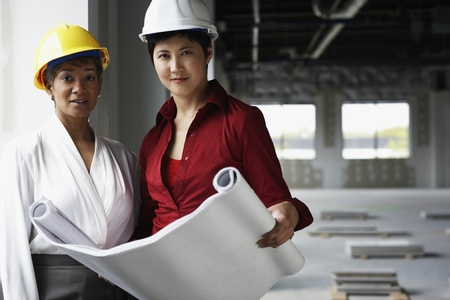 Two women at construction site LANG_EVOIMAGES