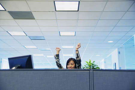 Businesswoman smiling with her hands raised in excitement LANG_EVOIMAGES