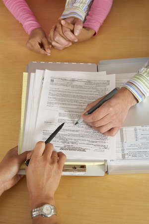 Couple signing mortgage paperwork