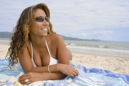 Hispanic woman lying on the beach, Florianopolis, Brazil