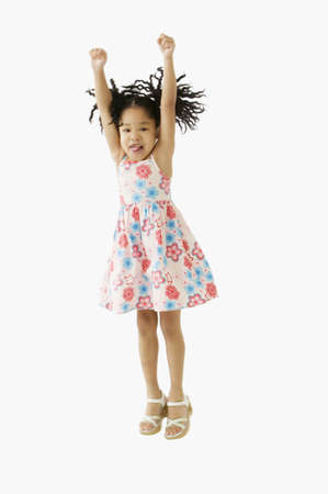 Studio shot of young African girl jumping