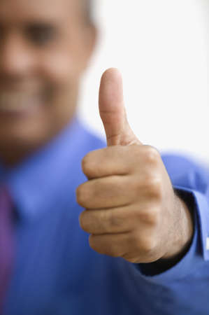 Close up of hand giving thumbs up