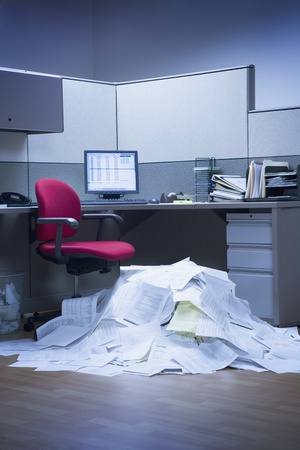Mountain of paper in office space