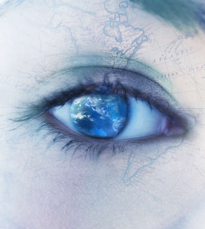 Close-up of a young womans eye shaded like a globe with skin tattooed like a map