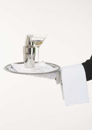 Butler holding a silver tray with a martini and shaker LANG_EVOIMAGES