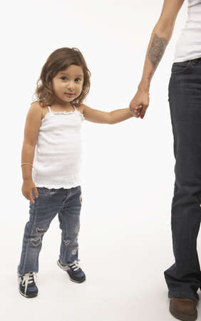 Young girl holding her mothers hand LANG_EVOIMAGES