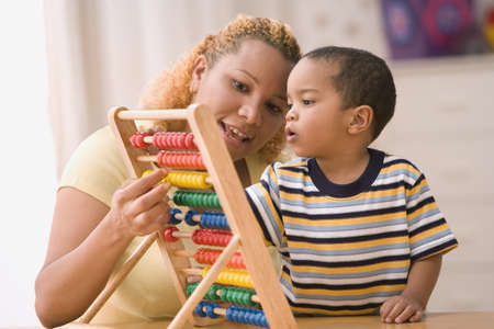 Mother teaching son with abacus