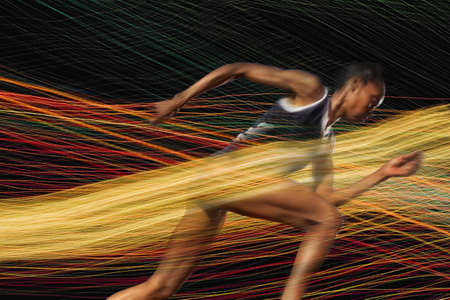 Female athlete running through threads of color