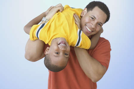 Father carrying young son on shoulder LANG_EVOIMAGES