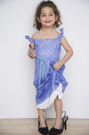 Portrait of girl playing dress up