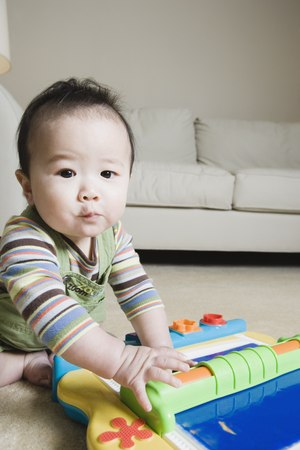 Asian baby playing on the floor