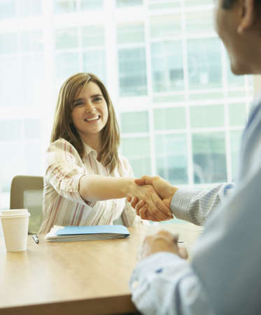 Businesswoman shaking hands with a businessman, Redwood City, California, United States