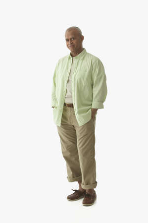 Portrait of man standing with hands in pockets LANG_EVOIMAGES