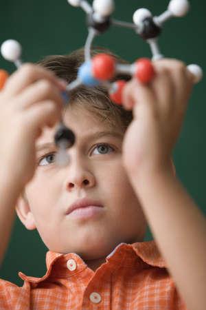 Young boy holding DNA model LANG_EVOIMAGES
