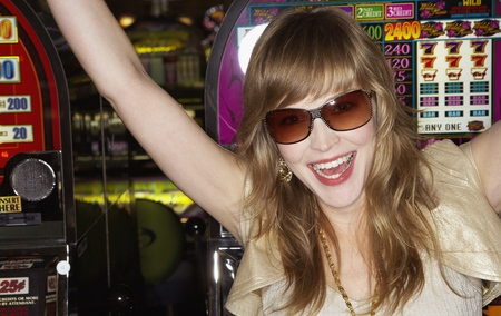 Young woman wearing sunglasses in a casino