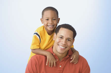 Portrait of father and young son smiling