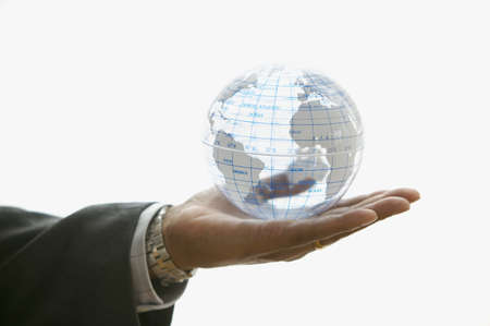 Close up of businessmans hand holding globe
