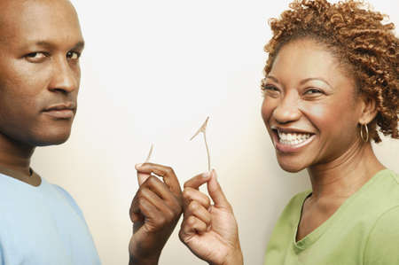 African couple holding broken wishbone