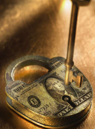 Key and lock with US Dollar bill imprinted on it LANG_EVOIMAGES