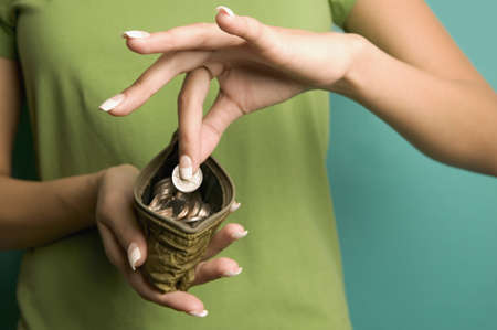 Close up of woman taking coin out of change purse