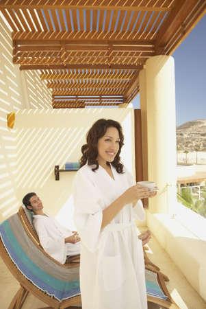 Couple on balcony at resort hotel, Los Cabos, Mexico