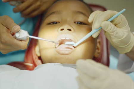 Dentist working on young African boy