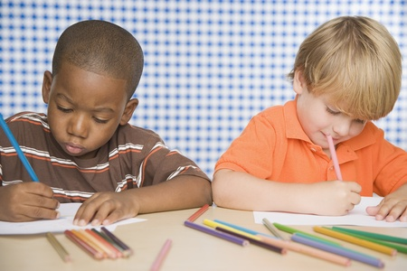 Two young boys coloring