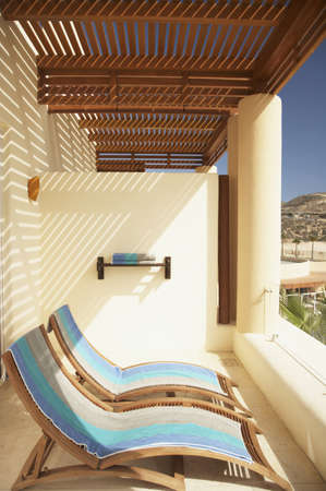 Resort hotel balcony with lounge chairs, Los Cabos, Mexico