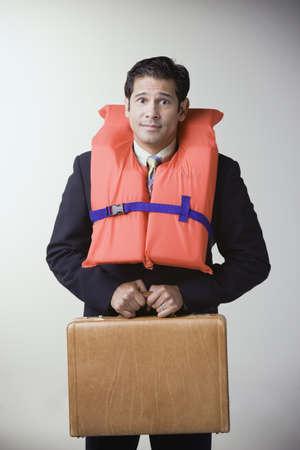 Hispanic businessman wearing life jacket LANG_EVOIMAGES