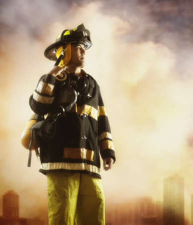 Male fire fighter with smoky background