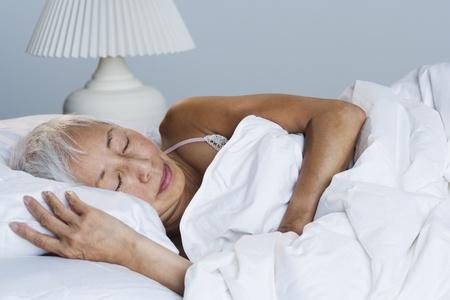 Senior Asian woman sleeping in bed