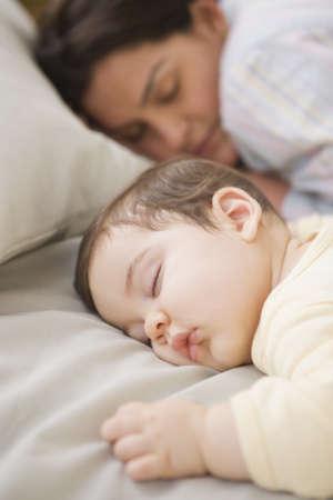 Hispanic mother and baby sleeping