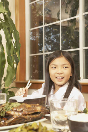 Young Asian girl eating at the table, San Rafael, California, United States