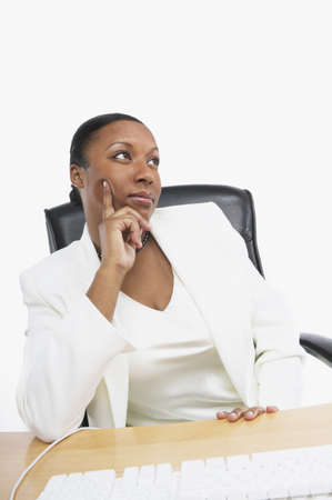 African businesswoman thinking at her desk, San Rafael, California, United States