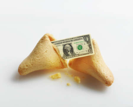 Broken fortune cookie with US Dollar inside