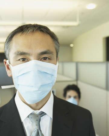 Asian businessman wearing doctorís mask