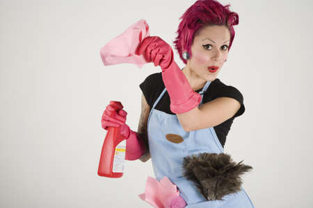 Studio shot of woman with cleaning supplies and rubber gloves LANG_EVOIMAGES