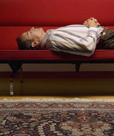 Businessman sleeping on sofa