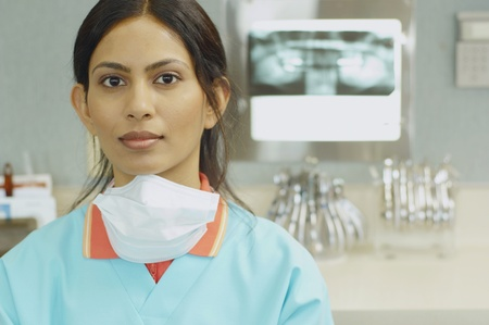 Indian female dental assistant next to x-rays LANG_EVOIMAGES