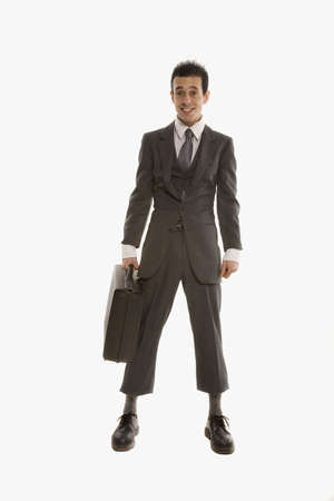 Hispanic businessman wearing suit that is too small LANG_EVOIMAGES