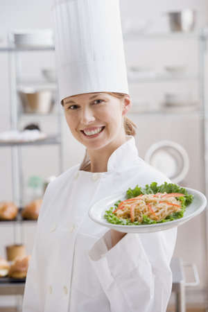 Female chef with plate of food