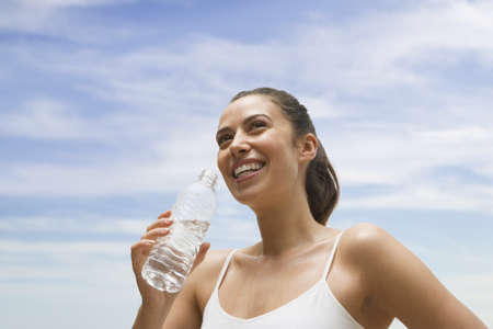 Woman drinking from water bottle