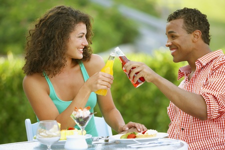 Couple toasting at outdoor restaurant